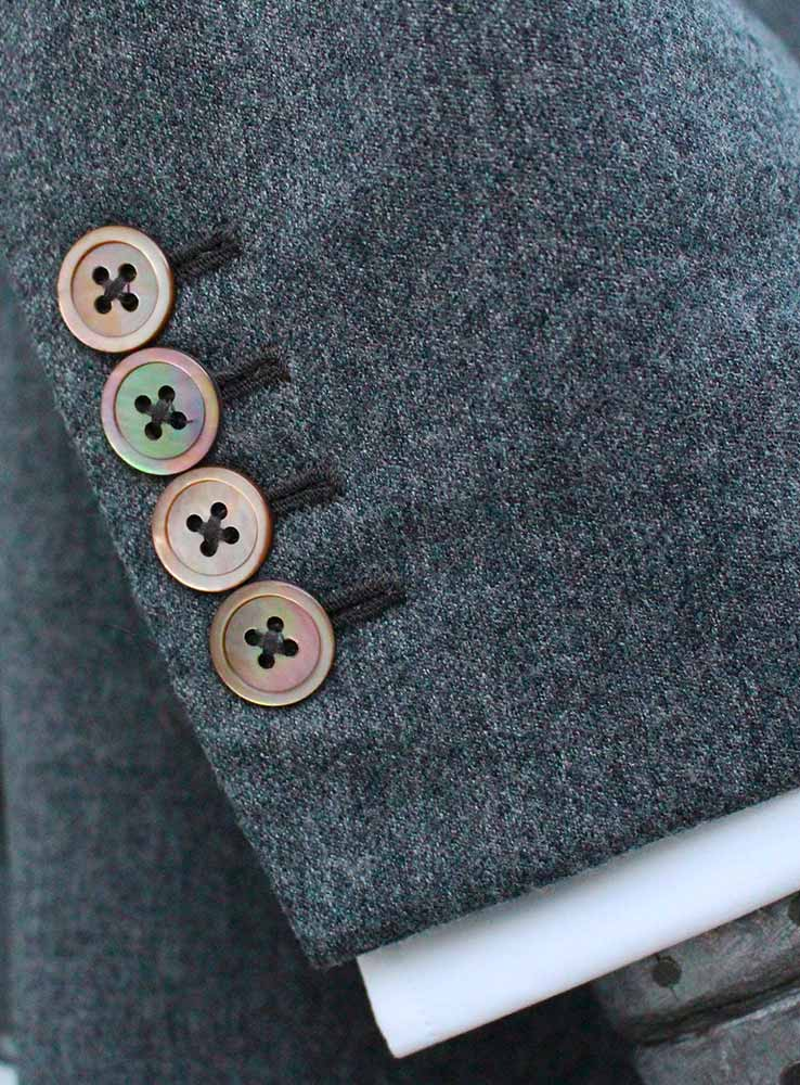 Grey flannel casual suit jacket cuff buttonholes